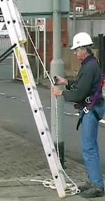 Engineer attaching to Ladder Safety System via Rope Grab