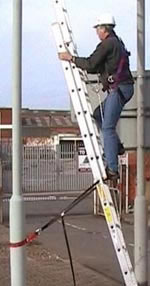 Engineer climbing ladder whilst connected via Rope Grab