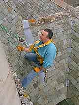 CSS Worksafe Engineer Using Rope Access Techniques to Inspect Fall Arrest Eyebolts at National Trust Property