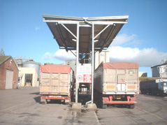 Twin bay lorry sheeting gantry with roof